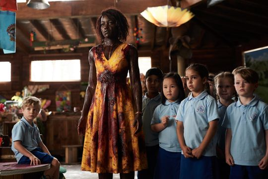 """indergarten teacher Miss Caroline (Lupita Nyong'o) protects her students from a zombie apocalypse in horror comedy """"Little Monsters."""""""