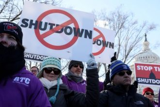Federal air traffic controller union members protest the US federal government shutdown at the U.S.
